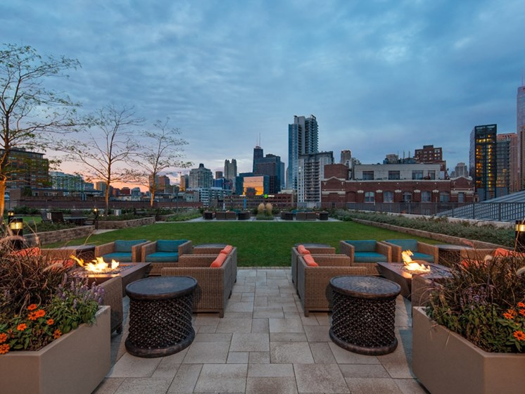 Outdoor fire pits with views of the Chicago skyline and green terrace area
