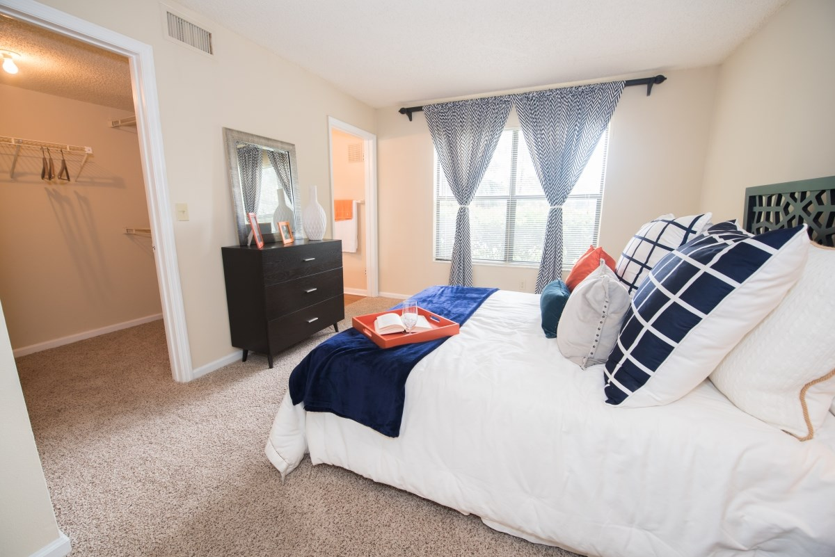 Grande Oasis apartments feature carpeting in bedrooms.