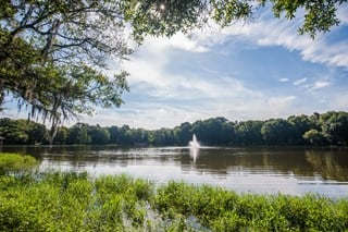 Grande Oasis residents enjoy the beautiful lakes while on the one mile walking trail.