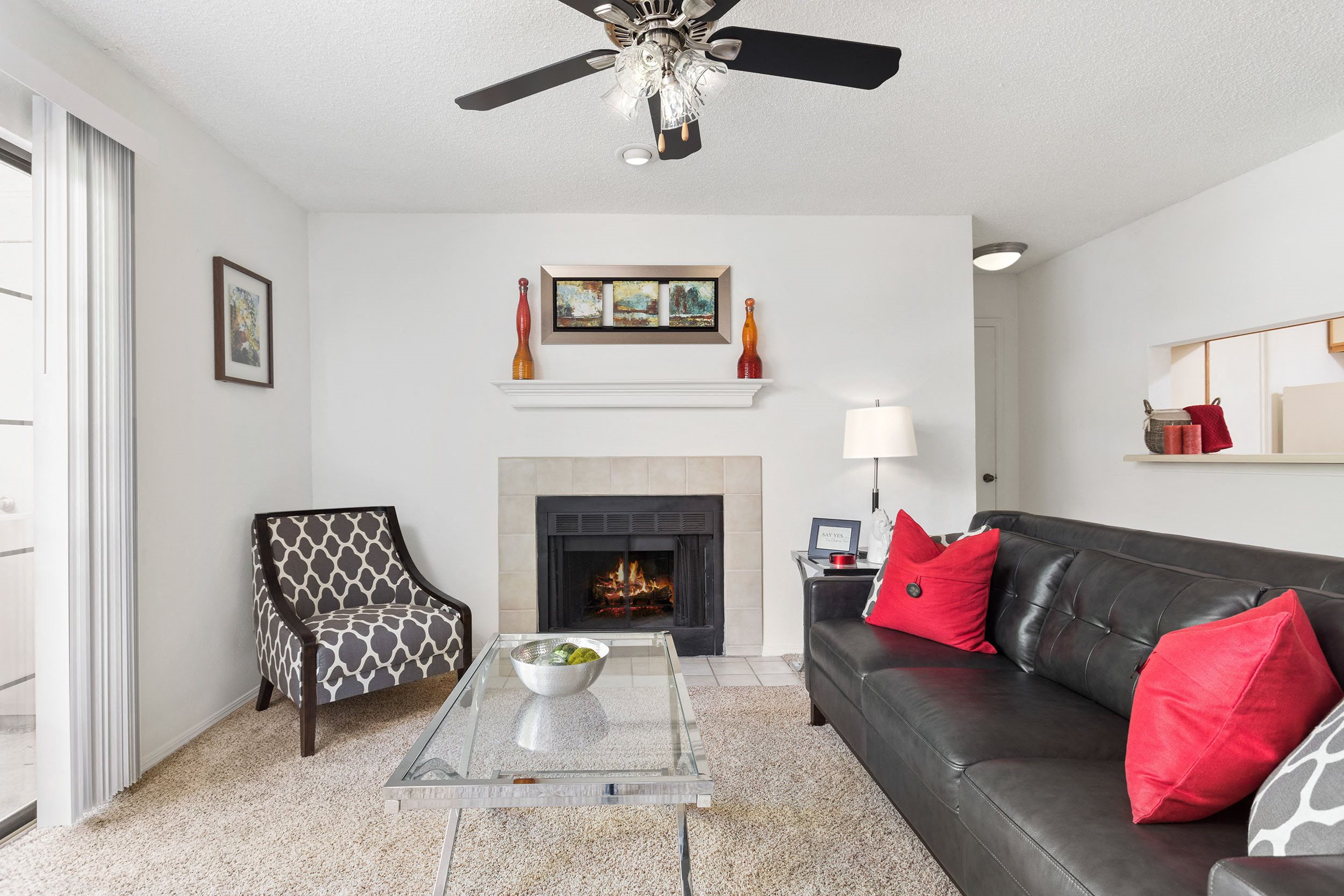 Living Room View with Fireplace and Ceiling Fan - The Augusta Apartments