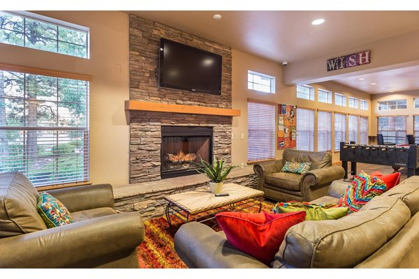 Highland Village Apartments Clubhouse with Fireplace and TV