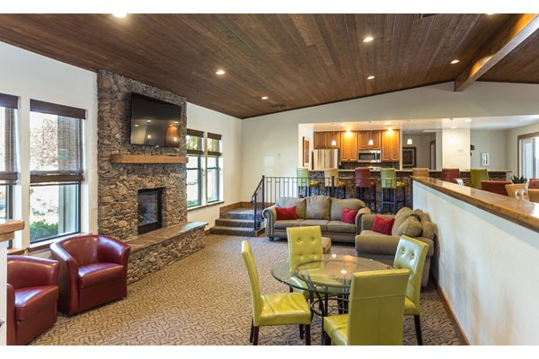 Clubhouse with TV, Fireplace, Pool Table, and Kitchen at Country Club Terrace Apartments