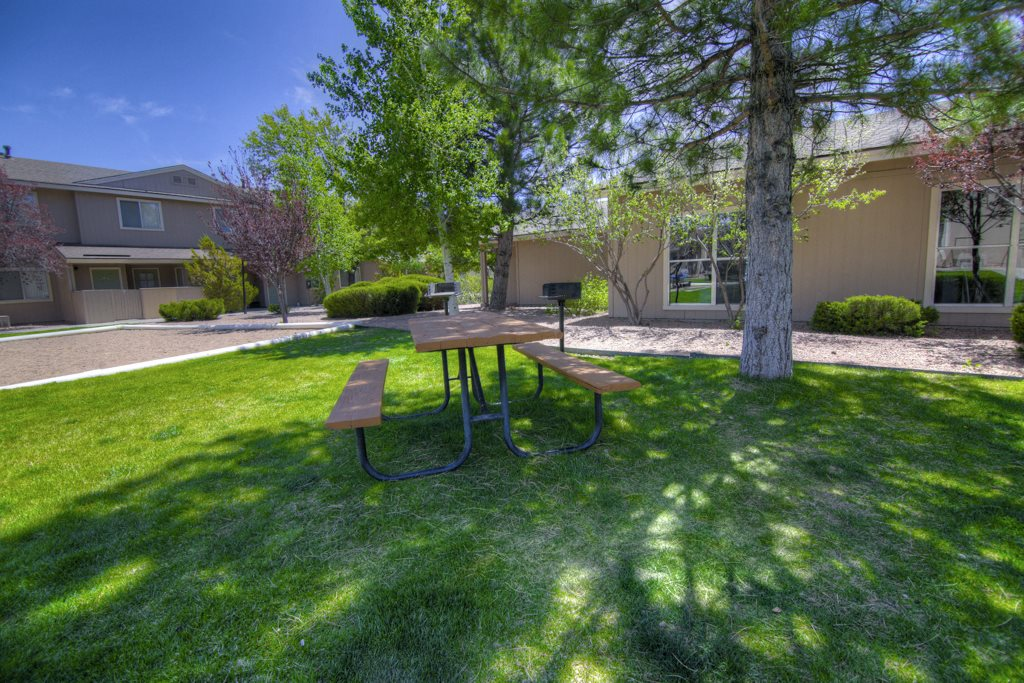 Picnic Tables and BBQ Grills at Country Club Terrace Apartments in East Flagstaff