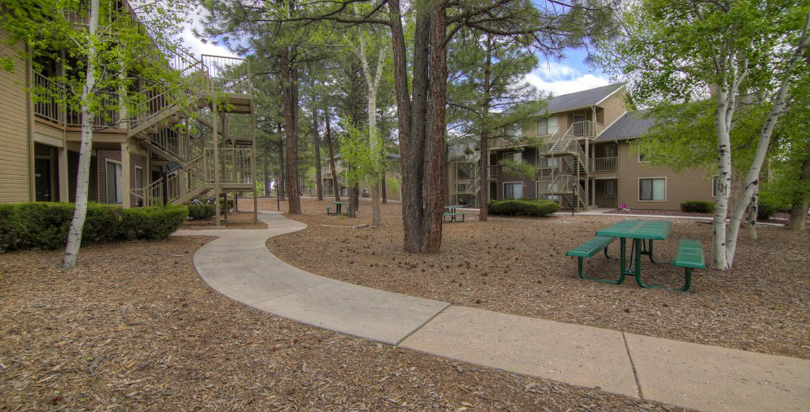 Garden siting like area , at Woodlands Village Apartments, Flagstaff, AZ, 86001