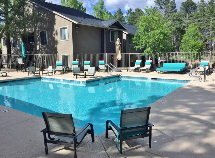 Pool with siting area  at Woodlands Village Apartments, Flagstaff, AZ,86001