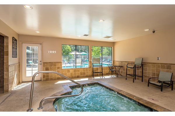 Indoor Hot Tub with TV at Woodlands Village Apartments
