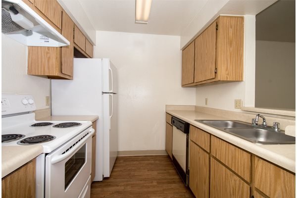 Full Studio Kitchen with Dishwasher and Double Sink at University Square Apartments in Flagstaff, AZ
