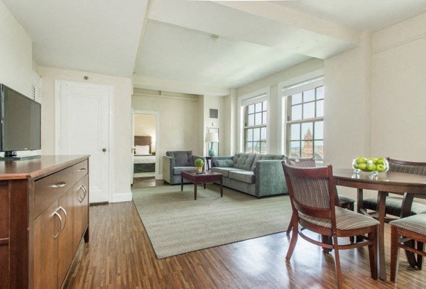 Open floor plans, oversized windows, and hardwood floors in many units.