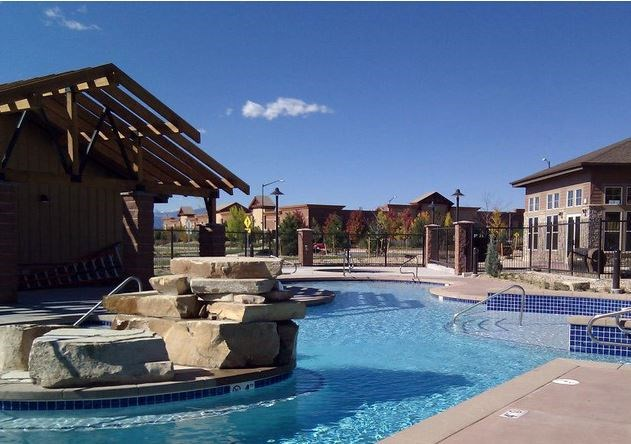 Swimming Pool at The Greens at Van de Water Apartments in Loveland, CO