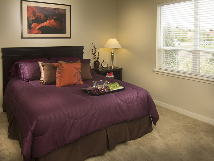 Bedroom at The Greens at Van de Water Apartments in Loveland, CO