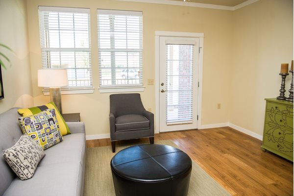 Wood-finish flooring through living areas at Westmoore Apartments in Oklahoma City, OK
