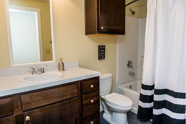 Upgraded bathrooms with modern dark cabinetry at Westmoore Apartments in Oklahoma City, OK