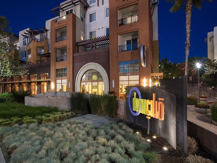 domicilio apartment exterior at night with sign