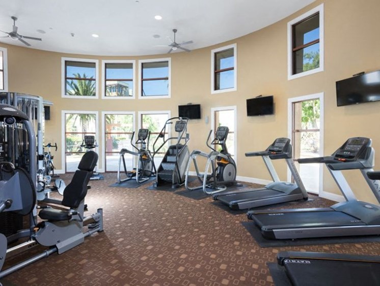 fitness center with multiple treadmills