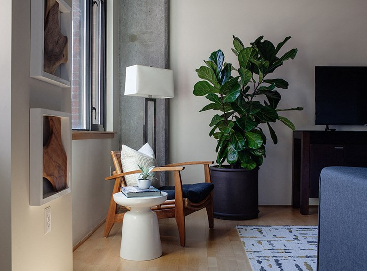 living room with a chair and planter