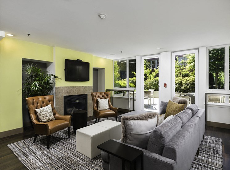 Clubhouse with lounge seating, wall tv and fireplace