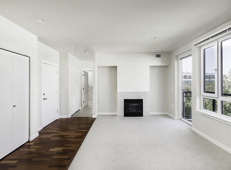 Vacant penthouse apartment home living room with fireplace