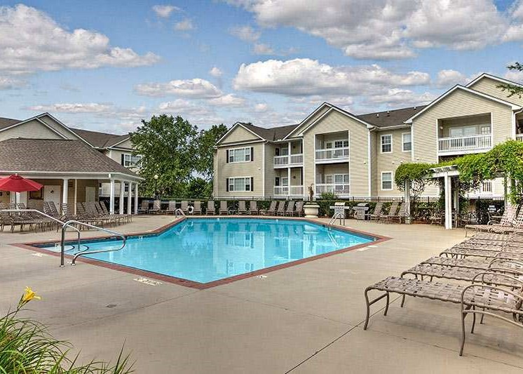 Take a dip in our resort-style swimming pool at Abberly Woods Apartment Homes, Charlotte