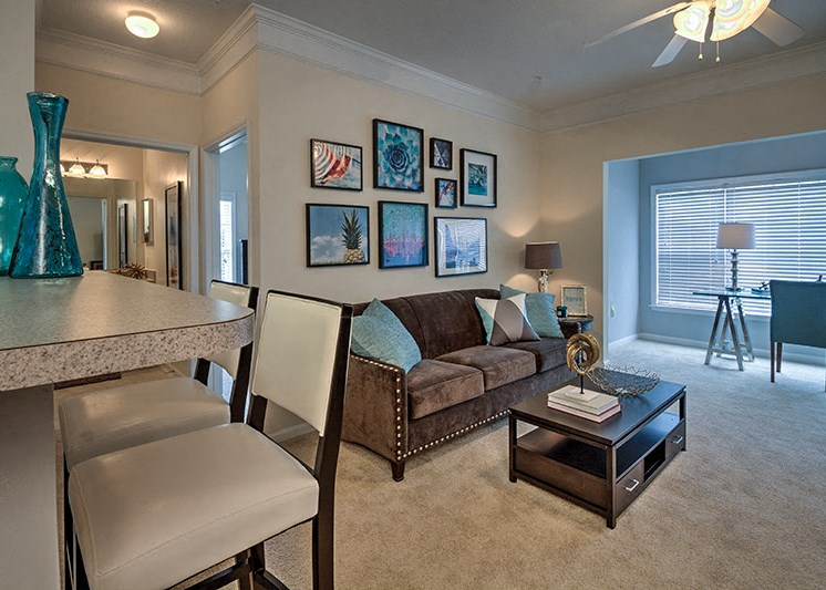 Living Room with Faux-Hardwood Floors at Abberly Woods Apartment Homes, Charlotte, NC
