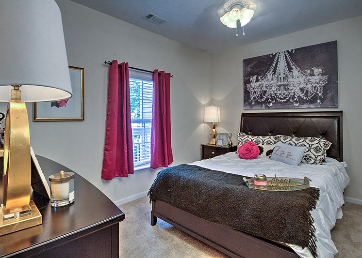 Wood-look flooring extends to bedrooms in select homes at Abberly Woods Apartment Homes, Charlotte, 28216