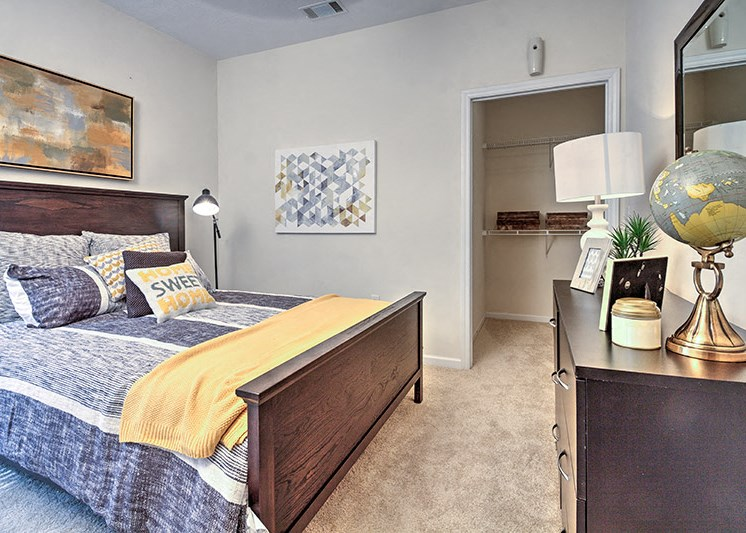 Bedroom with built-in desk at Abberly Woods Apartment Homes, North Carolina