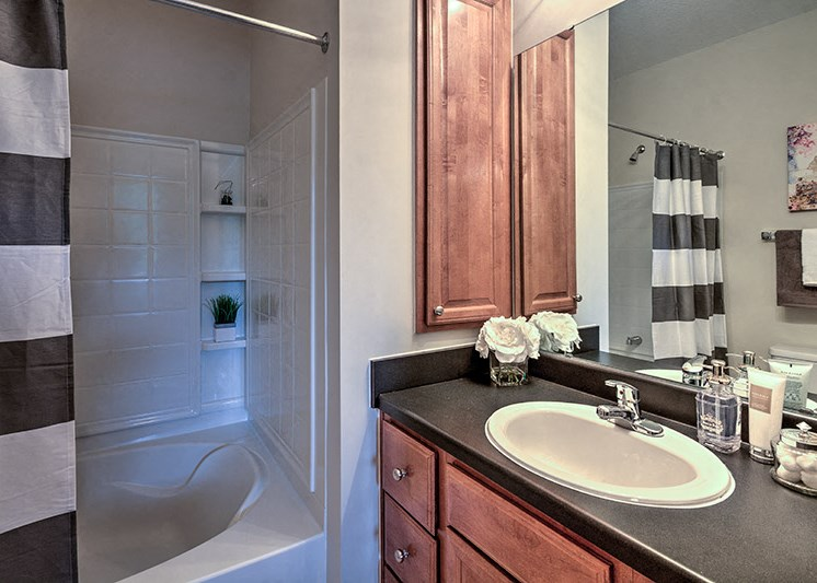 Bathroom with wall linen cabinet at Abberly Woods Apartment Homes, Charlotte, NC 28216