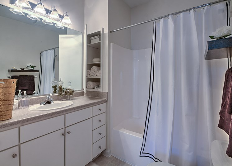 Bathroom with wall linen cabinet at Abberly Woods Apartment Homes, Charlotte