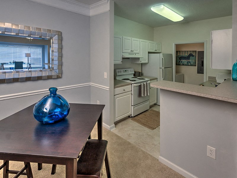 Well-lighted dining areas at Abberly Woods Apartment Homes by HHHunt, Charlotte, NC