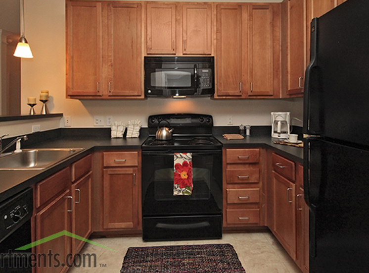 Spacious Kitchen with Pantry Cabinet at Abberly Crest Apartment Homes, Lexington Park, Maryland