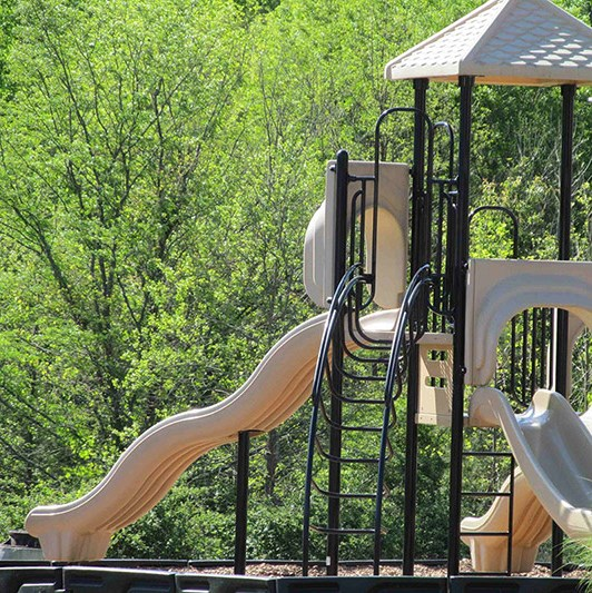 Playing area for children's  at Abberly Green Apartment Homes, Mooresville, NC 28117