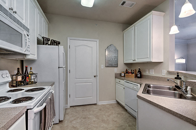 Newly renovated kitchens with tile back splash at Abberly Green Apartment Homes, Mooresville, NC
