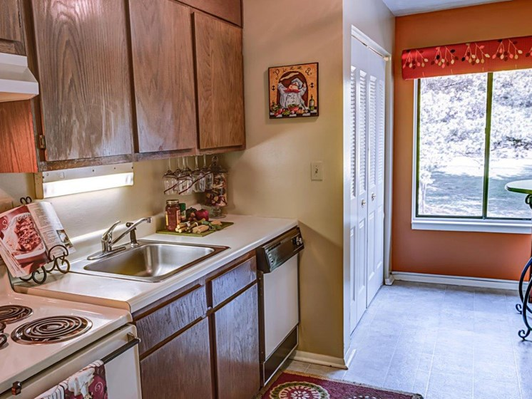Kitchen With Custom Cabinetry at Walden Pond Apartment Homes by HHHunt, Virginia, 24501