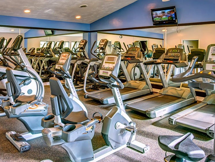 Up-To-The-Minute Fitness Center at Walden Pond Apartment Homes by HHHunt, Lynchburg, VA, 24501