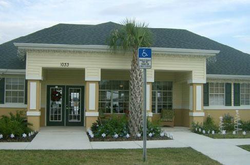 Beautifully Landscaped Entrance at Palms at Lake Tulane, 1033 Hal McRae Loop, 33825