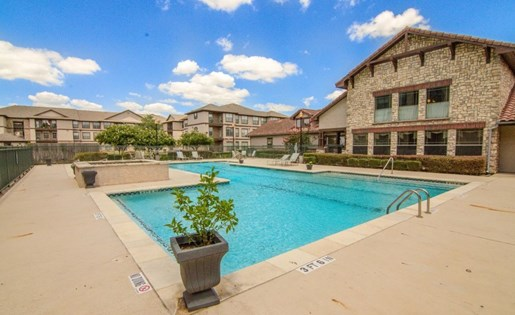 Poolside Lounge Area at Primrose of Pasadena - Active Senior Living, Pasadena, Texas