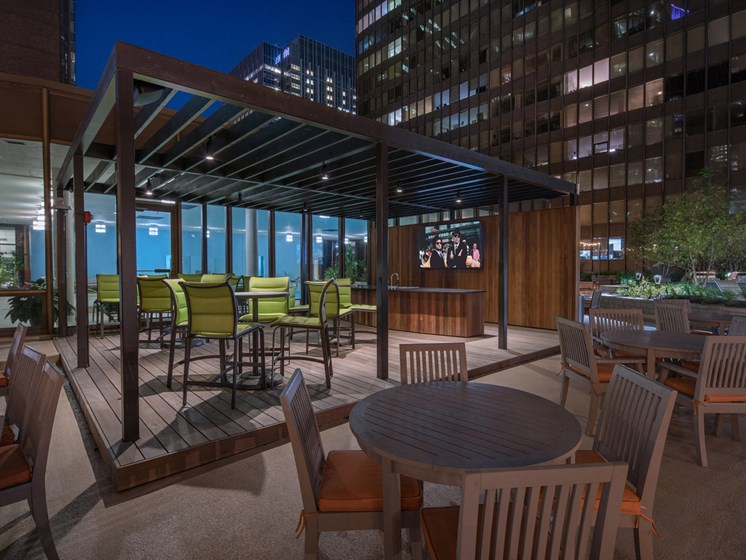 Outdoor kitchen and patio at dusk at McClurg Court.