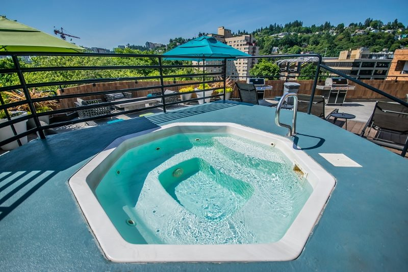 rooftop sundeck with pool and hot tub