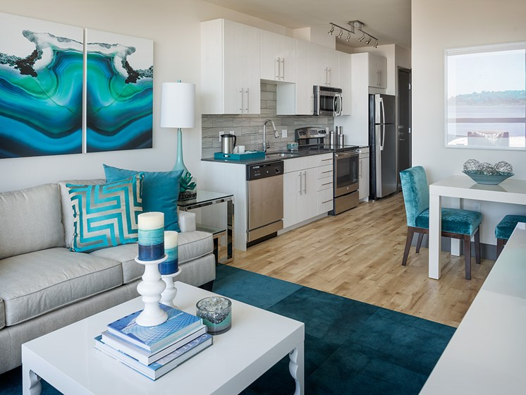 ArtHouse Luxury Apartments in Downtown Seattle WA - Kitchen With Stainless Steel Appliances, White Cabinetry and Beautiful Decor