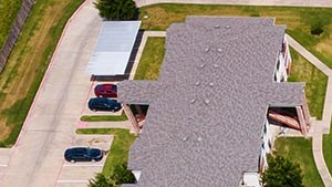 Arial view of the pool and playground at Bradford Place Apartments, Commerce Texas