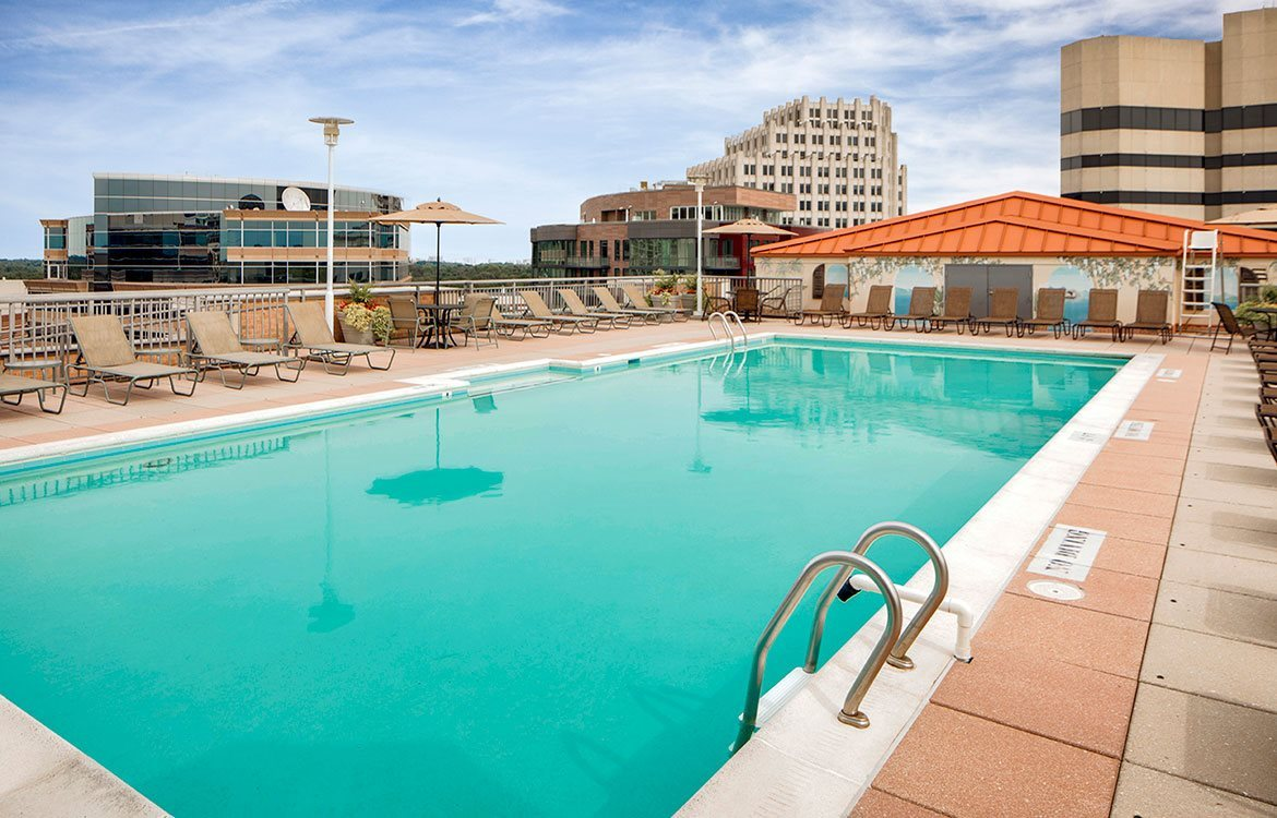 Resort-style rooftop pool with sundeck and stunning views of the city of Bethesda, MD.