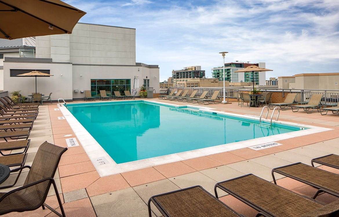 Sparkling rooftop pool and large sundeck with views overlooking the city at 7620 Old Gerorgetown Rd in Maryland.