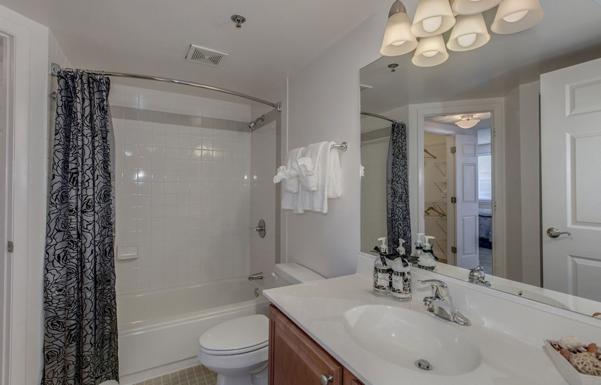 Modern bathroom at The Metropolitan in Maryland, with large shower and designer lighting.