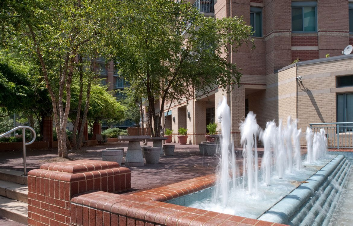 Relax by the water fountain in the private courtyard at The Metropolitan in Bethesda, MD.