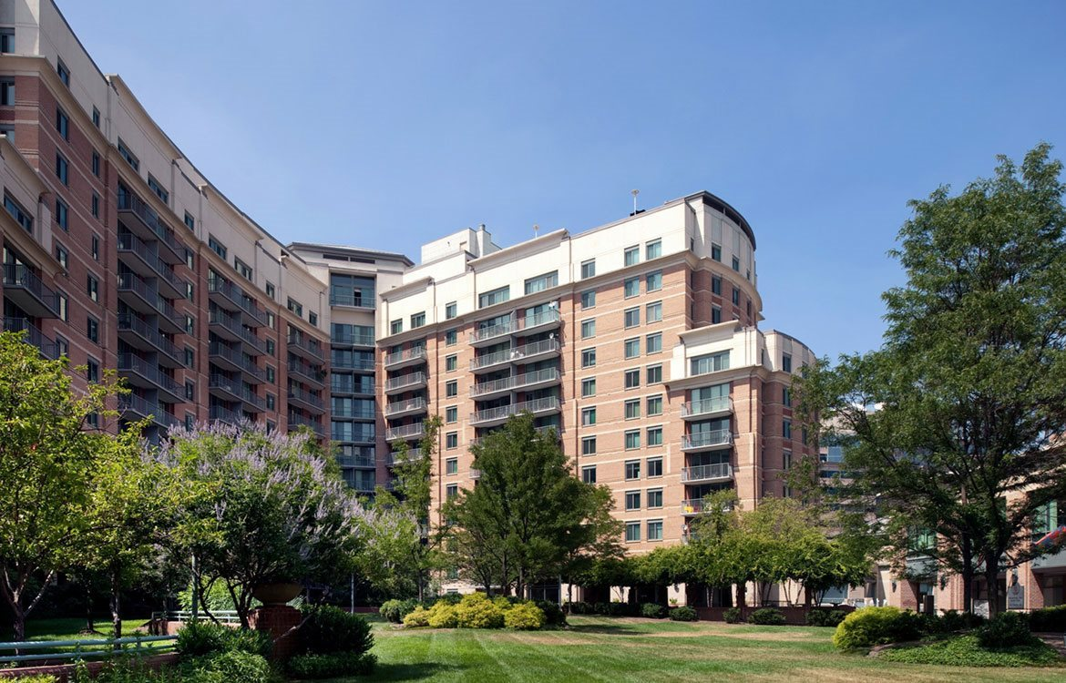 The Metropolitan in Bethesda building exterior, with balconies overlooking green landscaping.