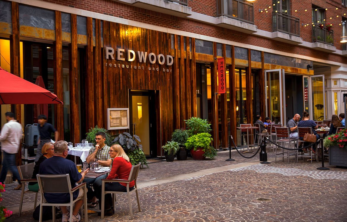 Redwood Bar, redwood accented restaurant and bar with outdoor shaded patio seating near The Metropolitan in Bethesda, Maryland.