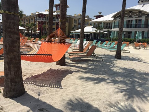 Resort Pool with Sand Beach Entry and Swim Up Bar