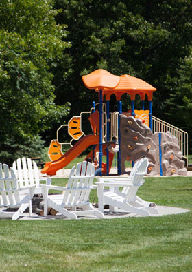 Playground and Outdoor Fire Pit at apartments in Spring Lake