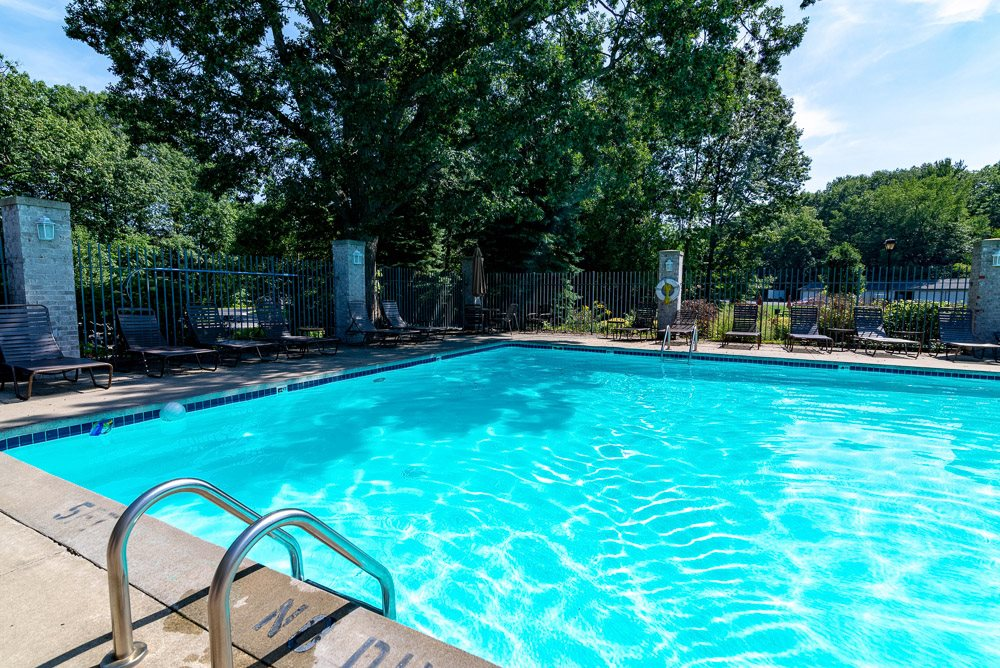 Outdoor Pool at Woodland Ridge Apartments in Grand Haven, MI
