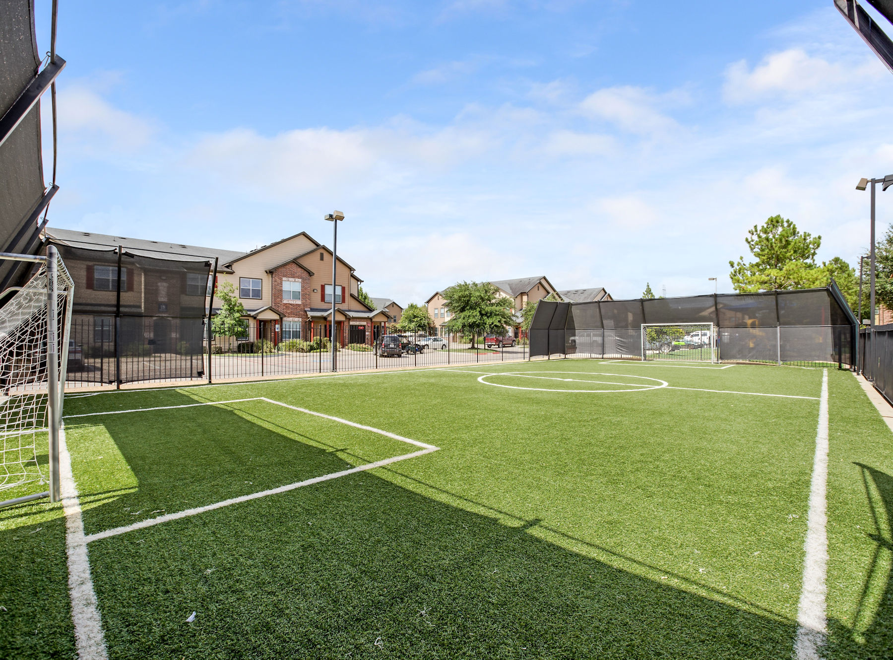 Soccer field with goals and lighting.