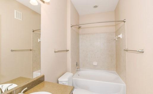Model bathroom with large bathtub.